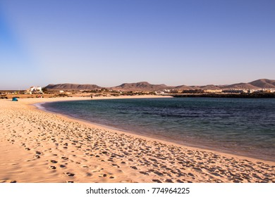 Beautiful Golden Sand Beach in Fuerteventura. La Concha in El Cotillo. Turquise water beach with mountains in the background