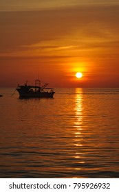 Beautiful golden scenery of  sunset  at harbor with a fish boat. Sabah?Malaysia