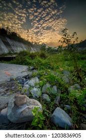 Beautiful golden sky at kali putih river. During merapi volcano eruption, many rock and lava material go through this river. kali putih river is located in muntilan, magelang, central java, indonesia