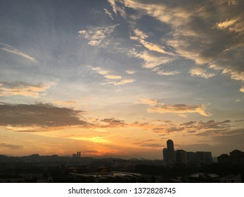 Beautiful golden sunrise views. There is a cloud group of blue and calm clouds. foreground silhouette.