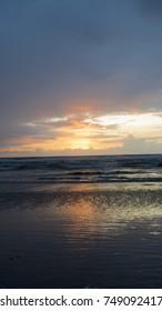 A beautiful golden sunset on Cannon Beach, Oregon.