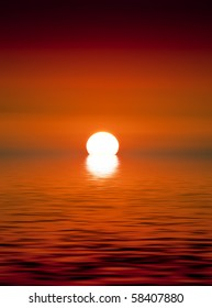 A beautiful golden sunset over calm ocean waters