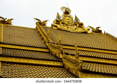 Beautiful golden temple roof. A golden church of buddhist temple and an ancient temple in Sri Pan Ton temple or Wat Sri Pan Ton at Nan province, north of Thailand.