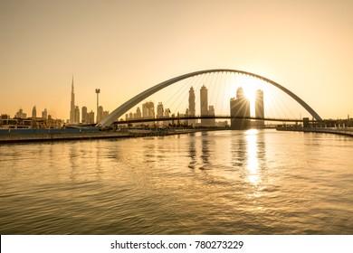Beautiful golden yellow sunrise over Dubai Downtown skyline. Dubai, UAE.