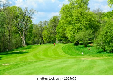 Beautiful golf course in fresh green colors of spring