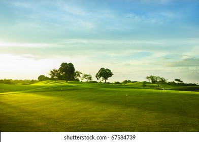 A beautiful golf course in the Philippines during sunset