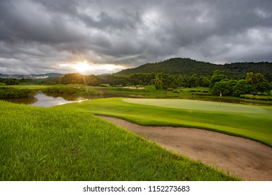 Beautiful golf course at sunrise time, Thailand.