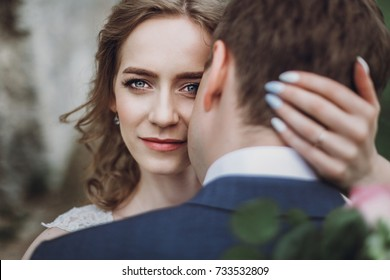 beautiful gorgeous bride and groom kissing. happy wedding couple hugging and embracing at old castle. happy romantic moments. elopement concept. sensual love. space for text