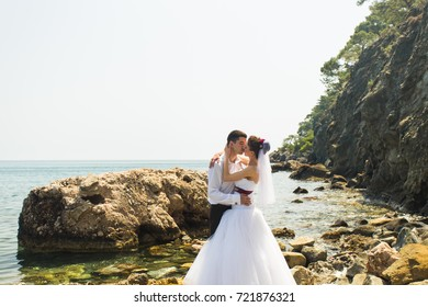 beautiful gorgeous bride and stylish groom on a beach