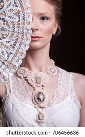 Beautiful gorgeous woman in victorian style in studio photo. Luxury and elegance