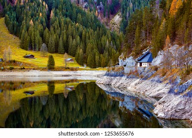 Beautiful Gosausee lake landscape with Dachstein mountains, forest, clouds and reflections in the water in Austrian Alps. Salzkammergut region.