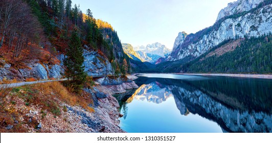 Beautiful Gosausee lake landscape with Dachstein mountains, forest, clouds and reflections in the water in Austrian Alps. Salzkammergut region