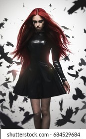 Beautiful goth mistress evil girl in black latex dress