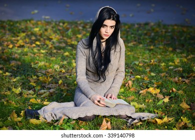 Beautiful Gothic Girl Reading A Book In Park