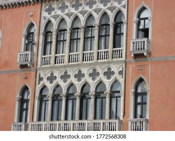 beautiful gothic windows on an orange builing