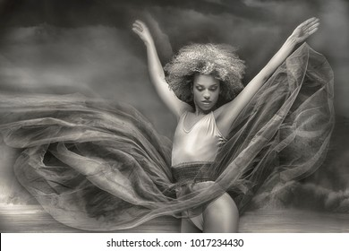 Beautiful graceful ballerine with afro hairstyle dancing. Ballet class training.