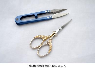 Beautiful graceful scissors for sewing, manicure scissors, scissors for seams on white fabric