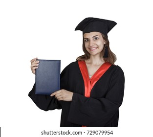 Beautiful graduate girl student in mantle showing blank placard board, isolated on white background.