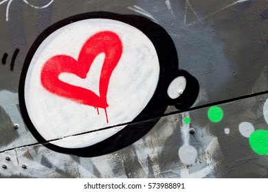 Beautiful graffiti design with heart on the wall in the Valentine's holiday style closeup. Urban contemporary iconic culture of street youth.