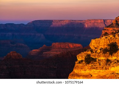 Beautiful Grand Canyon landscape overlook from the Hopi Point at sunset with vibrant and flaming colors, Arizona.