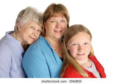 A beautiful grandmother, mother, and little girl with a very strong family resemblance.  Isolated on white.