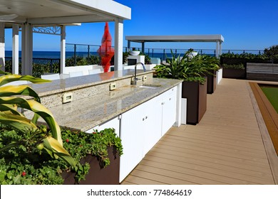 Beautiful granite countertop on a white cabinet located on an oceanfront outdoor terrace in a South Florida condominium.