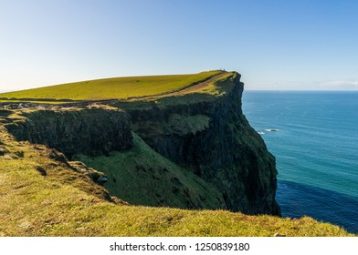 Beautiful grass covered cliffs facing the mighty ocean, landscape. Cliffs of Moher, Ireland's most spectacular natural wonder at the heart of the Wild Atlantic Way, County Clare.