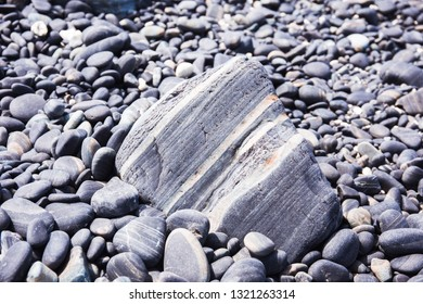 Beautiful gray rock pattern on the beach for background