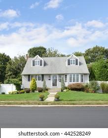 Beautiful Gray Suburban Home Landscaped Sunny Blue Sky Clouds Residential Neighborhood USA