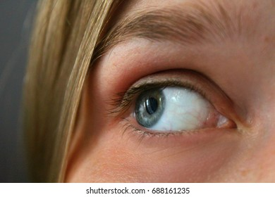 A beautiful gray woman is one eye closer, which transmits emotion