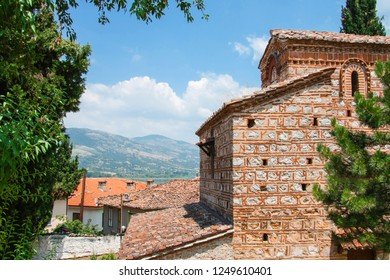 Beautiful greek landscape with mountain, Kastoria roofs and old bysantine church. Greece, Kastoria.