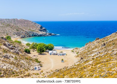 Beautiful greek summer sunny beach bay view to mediterranean blue sea awesome turquoise water like paradise with small white house village, Psili Ammos Beach, Patmos Island, Kos, Dodecanese, Greece