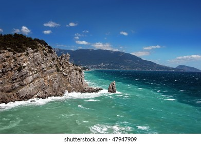 Beautiful green blue sea and mountains in summer day
