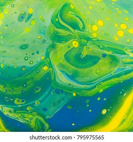 "Beautiful green, blue, yellow and silver acrylic paint ""dirty pour"" technique painting."