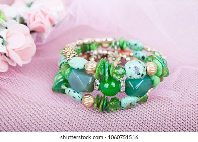 Beautiful green bracelet on a pink background