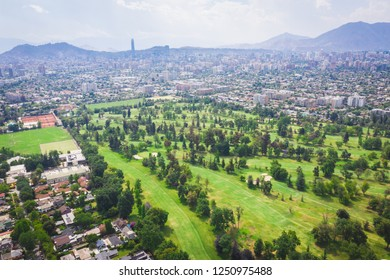 Beautiful Green Cityscape of Santiago de Chile with a golf course at the foreground
