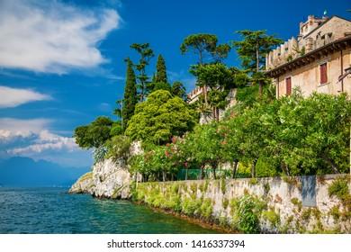 beautiful green coastline in the village Malcesine on the lake Garda, Italy