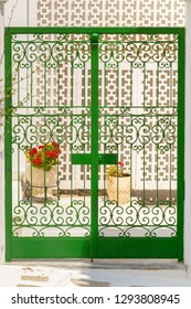 Beautiful green door at Andros island in Greece. Colors of Cyclades in mediterranean.