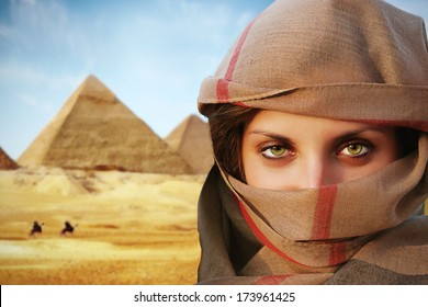 beautiful green eyed woman in chador and the pyramids