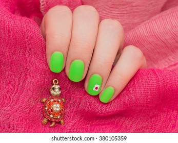 beautiful green female manicure. nails