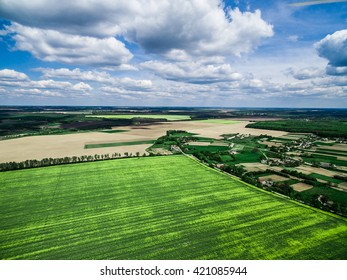 beautiful green field with village, view from height