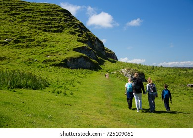 Beautiful green fields and hills of Ireland, hiking family with children