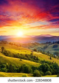 Beautiful green hills glowing by sunlight at twilight. Dramatic scene. Colorful sky. Carpathian, Ukraine, Europe. Beauty world.