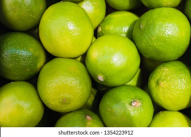 Beautiful Green lime pattern background. Limes in a box in the market