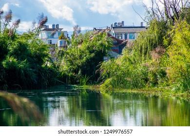 "The beautiful green park on Erhai lakeside in Dali, Yunnan province, China. Translation is ""Sweet home near lakeside""."