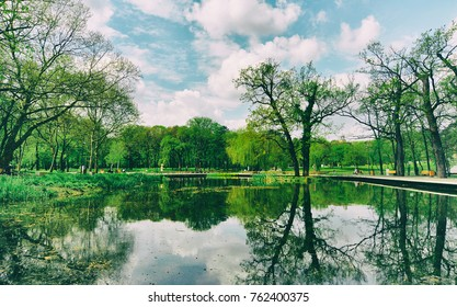 Beautiful green park with pound and trees in hungarian city Debrecen, Hungary.