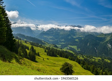 Beautiful green pastures and meadows in Swiss Alps as seen from Hoch Ybrig in canton of Schwyz