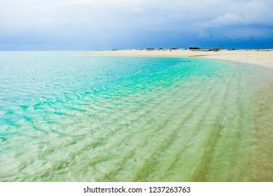 Beautiful green sea view of Tropical Beach in Maratua Island, Derawan Archipelago, North Kalimantan, Indonesia.