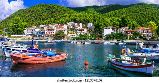 Beautiful green Skopelos island- traditional fishing village Neo Klima in Greece