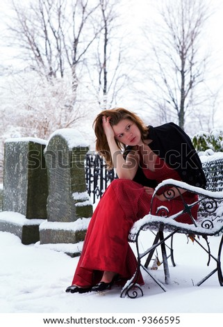 Beautiful Grief Stricken Teen In A Snow Covered Cemetery Cooling Filter Applied For